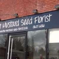 The Mustard Seed Florist logo